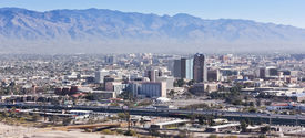 stock photo of pima  - A Daytime Aerial Shot of Interstate 10 Downtown Tucson Arizona and the Santa Catalina Mountains - JPG