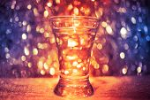 stock photo of vodka  - shot glass of vodka on shiny festive background - JPG