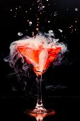 stock photo of vapor  - red cocktail with splash and ice vapor - JPG