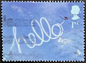 UNITED KINGDOM - CIRCA 2002: A stamp printed in Great Britain shows Aircraft Sky-writing 'hello'