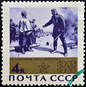A stamp printed in USSR (Russia) shows a Gerasirnow's paintings