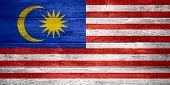 stock photo of malay  - flag of Malaysia or Malay banner on wooden background - JPG