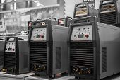 picture of inverted  - Industrial electricity inverters in a factory closeup - JPG