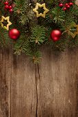 Old grunge wooden board  with Christmas border.