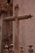 image of taxco  - Cross in Taxco Mexico with church in the background - JPG