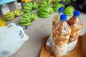 Bottles And Bananas At Town Market