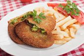 Breaded vegetable steak or burger with french fries