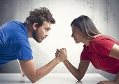 foto of wrestling  - Arm wrestling challenge between a young couple - JPG