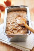 stock photo of walnut  - Mix of flour eggs bananas and chopped dark chocolate and walnuts in aluminum baking tin in process of making Banana cake with dark chocolate and walnuts - JPG