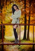 Young Caucasian sensual woman in a romantic autumn scenery. Fall lady