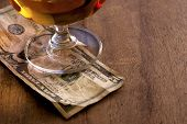 stock photo of abraham  - Tip Money for bartender on the wooden counter