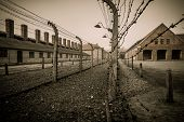 foto of concentration  - Electric fence in former Nazi concentration camp Auschwitz I - JPG
