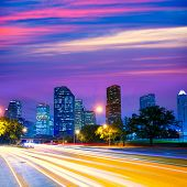 picture of nightfall  - Houston Texas modern skyline at sunset twilight with traffic headlights lights trace - JPG
