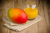 stock photo of mango  - Closeup detail of fresh mango juice and mango fruit - JPG