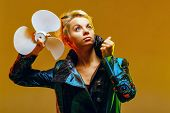 stock photo of jupe  - Girl in a jacket with a fan in hands shot in the studio - JPG