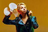 stock photo of bolero  - Girl in a jacket with a fan in hands shot in the studio - JPG