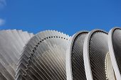 Steam Turbine Of Nuclear Power Plant Against A Blue Sky