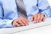 Hands of businessman with a computer keyboard.
