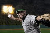 picture of ball cap  - Baseball Player on a Green Uniform on baseball Stadium - JPG
