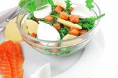 healthy diet food - fresh green lettuce salad with smoked salmon an light white goat feta cheese in