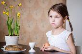 Small girl holding Easter egg in her hands