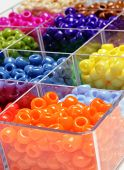 Closeup of beads in bins separated for making crafts jewelry