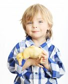 Happy little boy with cute duckling isolated on white background