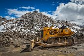 KHARDUNG LA PASS, INDIA - SEPTEMBER 12, 2012: Road construction at Kardung La the highest motorable