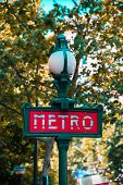 Paris metro sign on bright day