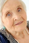 Close-up. Cute, elderly woman with happy face