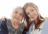 Close-up. Elderly woman and beautiful granddaughter with wide smile