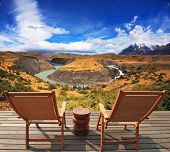 Two wooden chairs - on a wooden platform.  The comfortable place to enjoy the beauty of the landscap