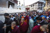KHATMANDU, NEPAL - DEC 15, 2013: Unidentified Buddhist pilgrims near stupa Boudhanath during festive