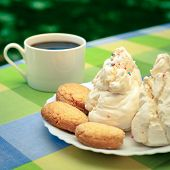 Sardinian sweets and cookies with moka pot outdoors