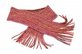 Pink winter scarf with fringe nicely arranged.