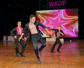 MOSCOW - MARCH 16: Unidentified male teens age 17-21 compete in latino dance on the Artistic Dance E