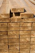 image of 2x4  - Stacks of wood planks in lumber yard - JPG