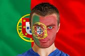 Composite image of serious young portugal fan with facepaint against digitally generated portugese national flag