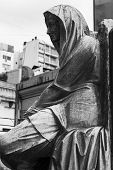 RECOLETA CEMETERY, BUENOS AIRES - MAR 14 2014 :  A memorial statuette marks a resting place.