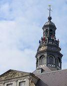 MAASTRICHT, NETHERLANDS - SEPTEMBER 8, 2013: Flags on the tower of town hall on the Market square. T
