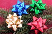 Christmas Bows Laid Around A Christmas Tree Branch