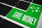 The word save money and idea and innovation graphic on black keyboard with green key