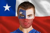 Composite image of serious young chile fan with facepaint against digitally generated chile national