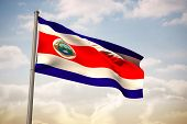 Costa rica national flag against beautiful blue sky with clouds