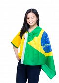 Excited football supporter with Brazil flag