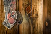 Wrought Iron Door Handle on a Rustic Cabin Door