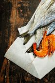 fresh dorado fish and shrimps on wooden board - food and drink