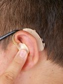 Young Man Wearing Hearing Aid