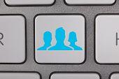 Business Blue People on Keyboard