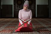 foto of tasbih  - Muslim Woman Reading Holy Islamic Book Koran - JPG